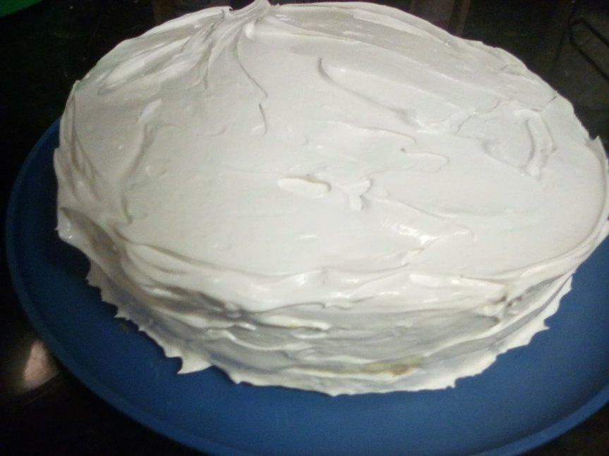 lemon meringue cake with lemon custard filling and an Italian meringue frosting